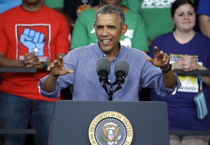 Sobre su propuesta de aumento al salario mínimo, el presidente Obama dijo que no aceptará un no por respuesta. (AP)