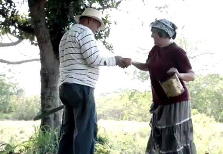"""Captura de pantalla del video del grupo cubano """"Cuentas claras"""" interpretando el rap """"Pueblo colombiano pa' la mesa"""". (Youtube.com)"""