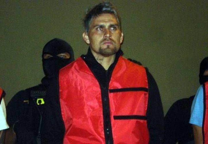 Omar 'El Gato' Ortiz y sus cómplices enfrentan cargos por plagiar a tres personas en septiembre de 2011. (mediotiempo.com)