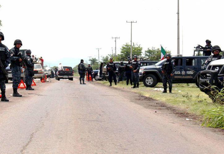 Luego del enfrentamiento que dejó 11 muertos en la comunidad de La Ruana, Michoacán, la Gendarmería instaló retenes. (Archivo/Notimex)