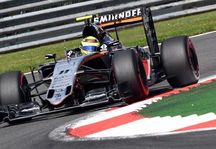 Sergio <i>Checo</i> Pérez, terminó en quinto sitio en el Gran Premio de Bélgica en el que resultó ganador Nico Rosberg. (AP/Geert Vanden Wijngaert)