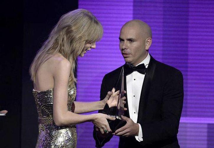 El cantante Pitbull será el conductor de la emisión 2014 de los American Music Awards. (Facebook/Pitbull)