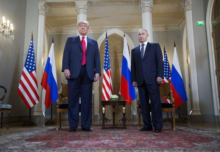 Vladímir Putin y Donald Trump, realizaron su primera cumbre unilateral en Helsinki. (AP)