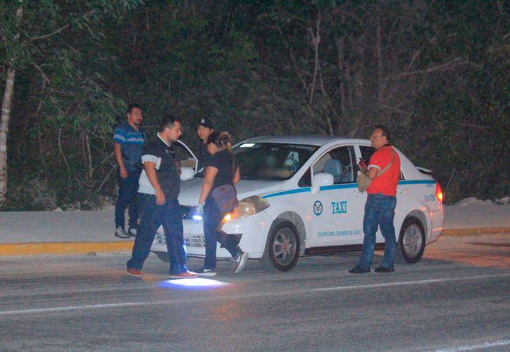 El chofer del taxi 258, placas 9845-TRZ, fue identificado como Carlos N. (Redacción/SIPSE)