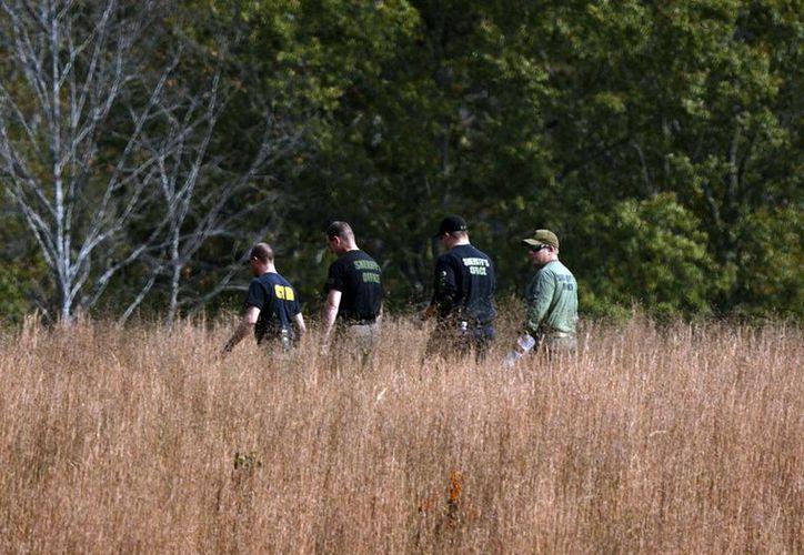 Investigadores excavan en la zona en busca de más cuerpos. (Foto: AP)