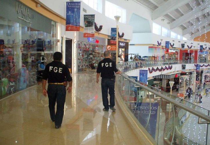 Creció la efectividad de la FGE en la captura de los delincuentes. Imagen de agentes de la FGE en una conocida plaza de Mérida. (Milenio Novedades)