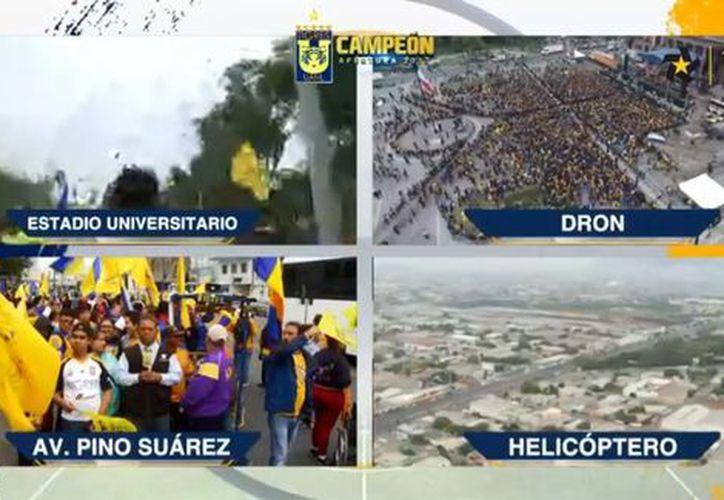 Jugadores de Tigres y sus fieles aficionados desfilan por las calles de Monterrey. (Capturas Milenio)