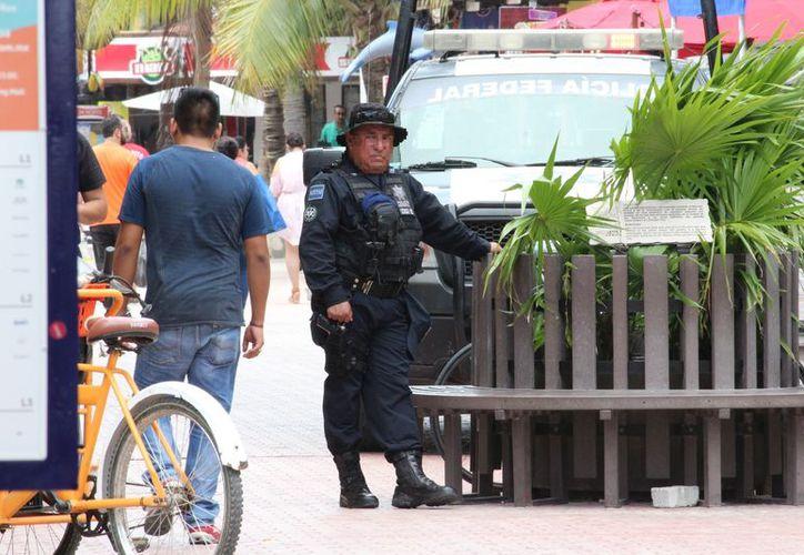 Seguridad Pública a reforzado la presencia de elementos en las zonas más concurridas. (Foto: Redacción/SIPSE)