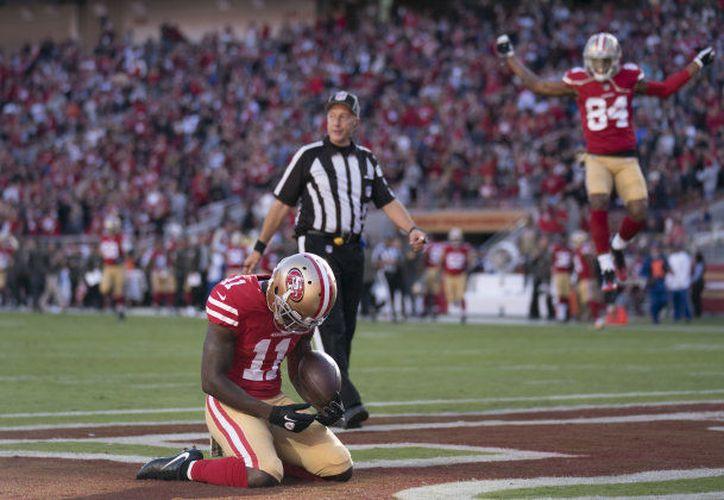 El jugador cayó de rodillas con mucha tristeza después de una recepción de touchdown. (Foto: Huffingtonpost)