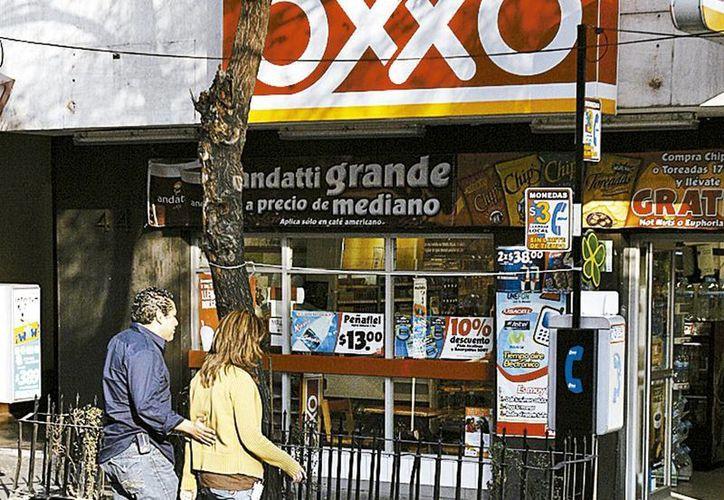 La cadena Oxxo tiene 12 mil 204 tiendas en el país y está en constante crecimiento. (Milenio)