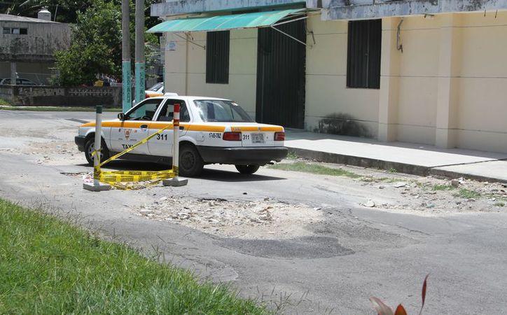 Actualmente existe 30 mil metros cuadrados de dañado por desfonde en el primer cuadro de la ciudad. (Joel Zamora/SIPSE)