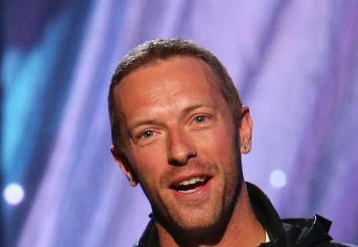 Se pondrá en subasta el proximo 24 de junio, la primera guitarra del líder y vocalista de Coldplay Chris Martin. (Fotografía: i.huffpost.com)