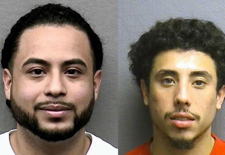 Michael Armando Arce y Jesse Irvin Zelaya, detenidos por la policía de Houston Texas, acusados de robar más de 100 vehículos utilizando una laptop. (Foto: Houston Police Department via AP)