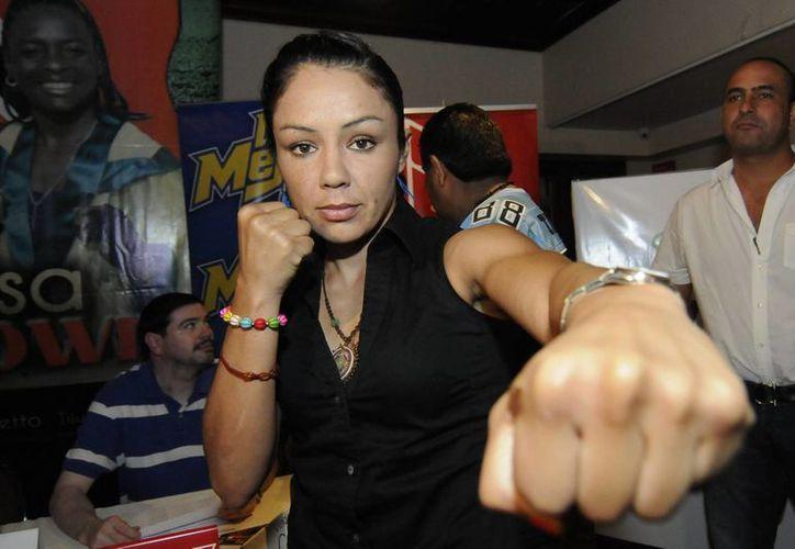 La boxeadora Jacqueline Nava contiende por una diputación federal por Baja California arropada por el Partido Acción Nacional. (Archivo/Notimex)