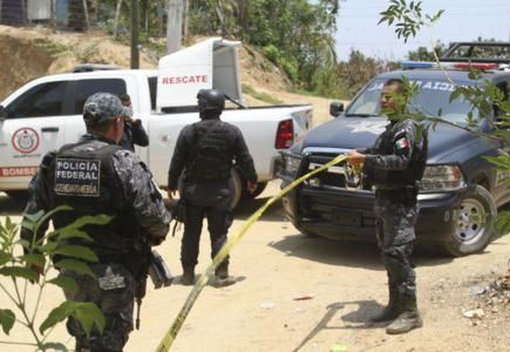 Tres policías municipales perdieron la vida esta mañana en un enfrentamiento con hombres armados en el municipio de Cualac. (El Financiero)