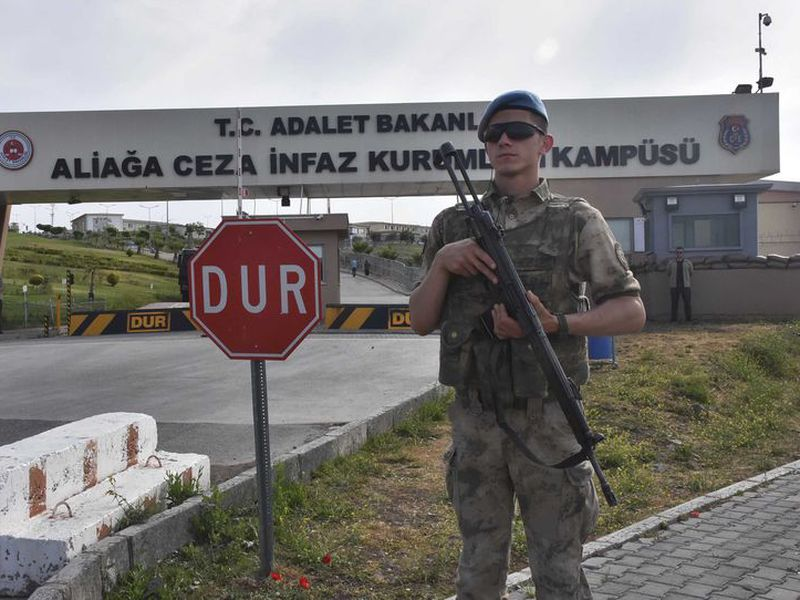 A Turkish soldier guards the entrance to the prison complex in Aliaga, Izmir province, western Turkey, where jailed US pastor Andrew Craig Brunson is appearing on his trial at a court inside the complex. (AP)
