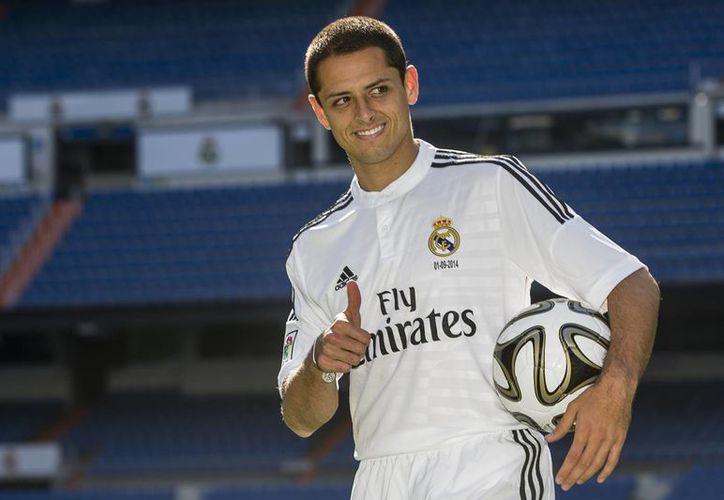 Hace seis años Javier Hernández jugaba en Chivas de Guadalajara. Hoy puede presumir de haber jugado en dos Mundiales y de haber estado en el Manchester United y el Real Madrid. (Foto: AP)