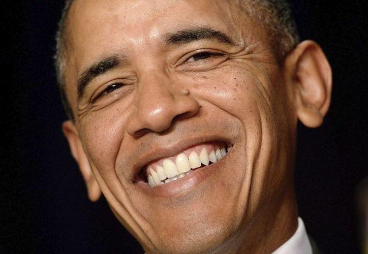 Obama y la primera dama, Michelle, van camino de convertirse en la pareja presidencial que más veces ha salido a cenar. (Archivo/EFE)