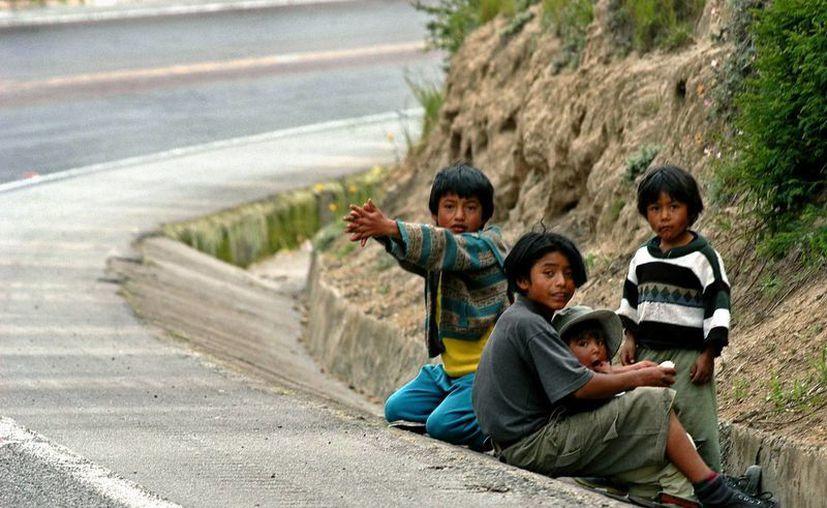 El año pasado, la cifra global de hondureños deportados de Estados Unidos y México superó los 80 mil, de acuerdo a datos oficiales. (Archivo/EFE)
