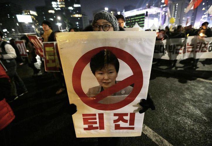 La presidenta surcoreana es acusada de abuso de poder, corrupción y tráfico de influencias. (AP/Ahn Young-joon)
