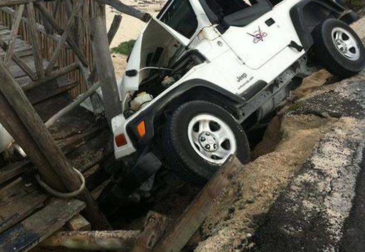 El automóvil pertenecía a una arrendadora, la cual le otorgo el perdón al conductor. (Gustavo Villegas/SIPSE)