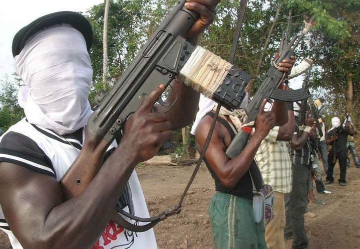 Militantes nigerianos entrenan en la región del Delta del Níger al sur de Nigeria. (EFE/Archivo)