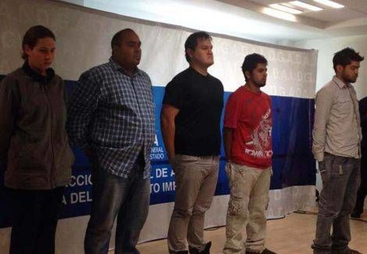 Angélica Fascineto Merlo y los cuatro sujetos que perpetraron el secuestro del comerciante. (Foto especial/MILENIO)