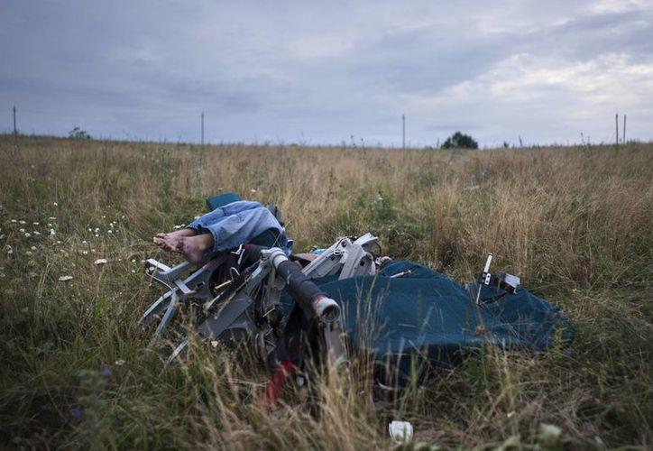 La tragedia del avión de Malaysia Airlines en Ucrania tiene fuertes implicaciones políticas, en particular en el Europa Central y Oriental. (AP)