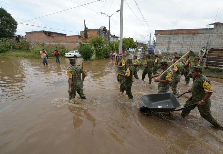"""Se activó el Plan DN-III en apoyo a la población, en los lugares afectados por los fenómenos hidrometeorológicos """"Manuel"""" e """"Ingrid""""."""