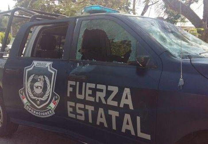 Estudiantes de la Normal Rural de Ayotzinapa se enfrentaron a policías federales en Chilpancingo, Guerrero. (Fotos: Milenio)