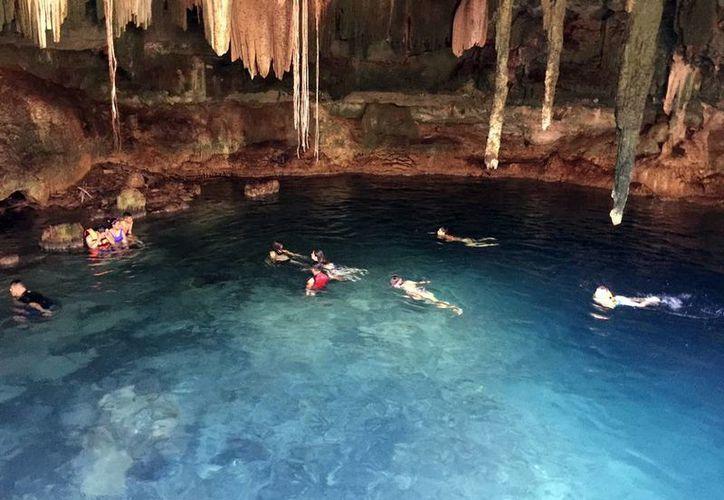 El Gobierno apoya los proyectos de inversión para que los pueblos mayas exploten atractivos turístico en su localidad, como los cenotes. (Archivo/Milenio Novedades)
