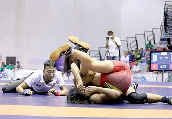 La destacada luchadora no ha interrumpido su preparación, con el objetivo de llegar a lo más alto. (Miguel Maldonado/SIPSE)