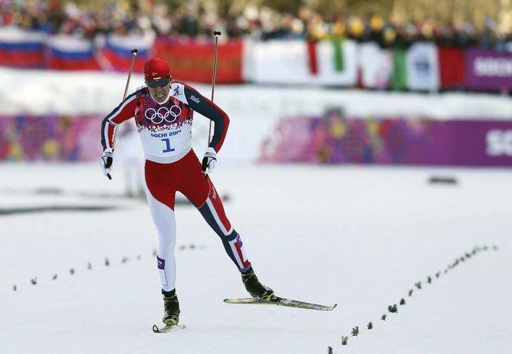 El noruego Ola Vigen Hattestad superó por apenas 1.2 segundos al sueco Teodor Peterson para ganar la medalla de oro. (EFE)