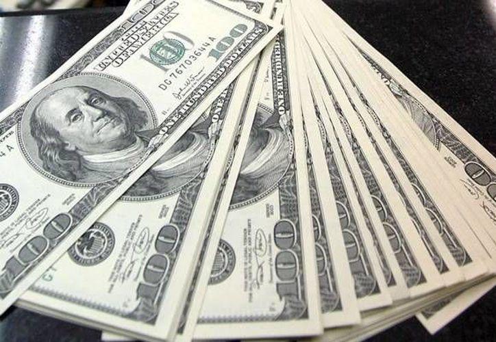 Se abre la jornada cambiaria con una apreciación marginal de 0.16 por ciento o 3.26 centavos al cotizar alrededor de 20.41 pesos por dólar. (Archivo)