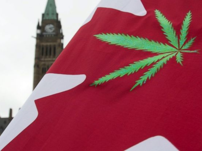 A Canadian flag with a cannabis leaf flies on Parliament Hill during a 4/20 event in Ottawa, Ontario.