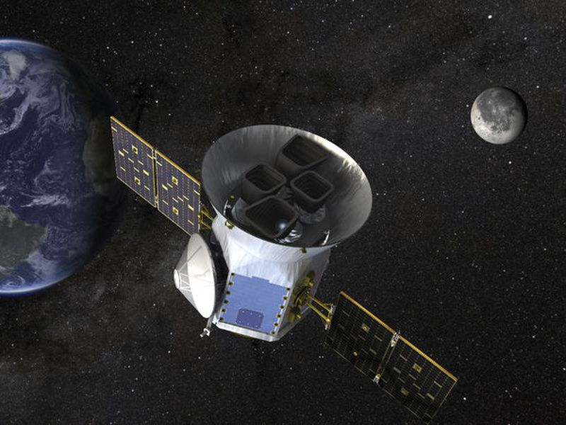 This image made available by NASA shows an illustration of the Transiting Exoplanet Survey Satellite (TESS). Scheduled for an April launch, the spacecraft will prowl for planets around the closest, brightest stars. These newfound worlds eventually will become prime targets for future telescopes looking to tease out any signs of life.