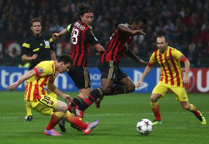 Barcelona quedó en el primer lugar del Grupo H con 7 puntos, seguido por el Milan con 5. (Agencias)