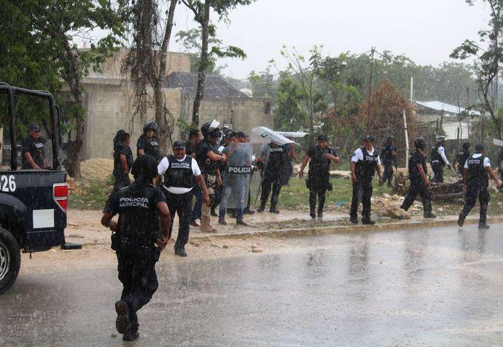 Durante el enfrentamiento se registró una fuerte lluvia. (Octavio Martínez/SIPSE)