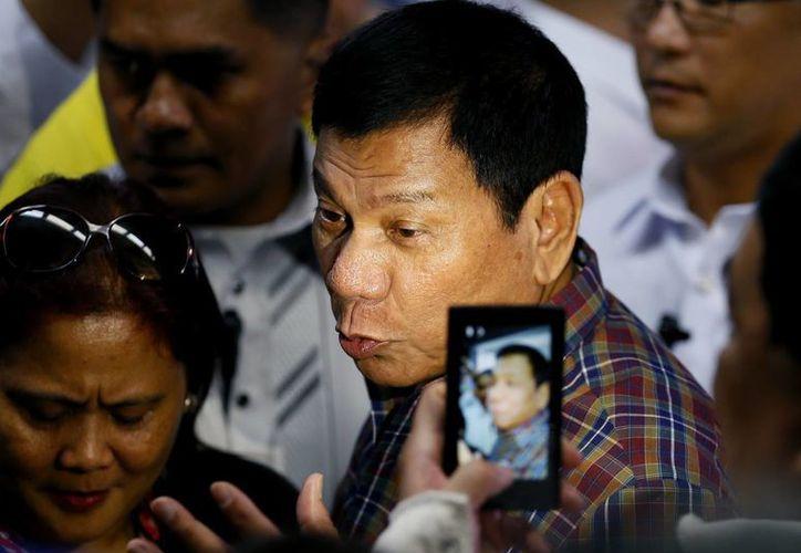 El presidente Duterte está bajo intensas críticas mundiales debido a la ejecución de miles de presuntos delincuentes desde que llegó al poder. (AP/Bullit Marquez)