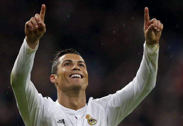 Cristiano Ronaldo, quien acaba de de ganar la Bota de Oro y el premio al Mejor jugador de la Liga de España por la temporada pasada, en esta lleva 23 tantos en 17 partidos. (EFE)