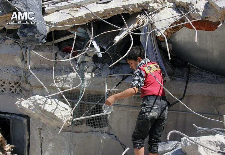 En las últimas semanas, las fuerzas del régimen sirio han bombardeado intensamente la ciudad de Mleiha. (AP)