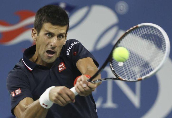 Novak Djokovic requirió de 3 horas y 32 minutos para poder eliminar a Andy Murray en cuartos de final del Abierto de Estados Unidos. (Foto: AP)