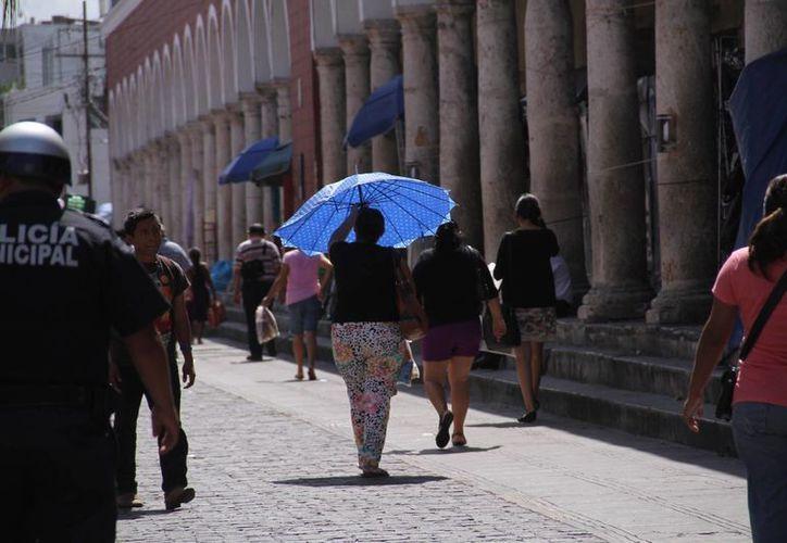 Tras el calor de este jueves en Yucatán, se espera hoy un descenso en la temperatura por la mañana y la tarde, pero no muy significativo. (Jorge Acosta/Milenio Novedades)