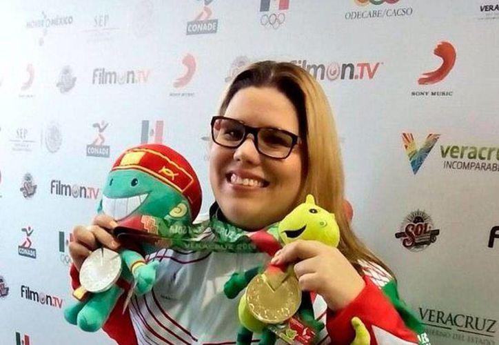Alejandra Zavala sumó un oro más para México, en tiro con pistola de aire de los Juegos Centroamericanos y del Caribe Veracruz 2014. (Twitter @Conade)