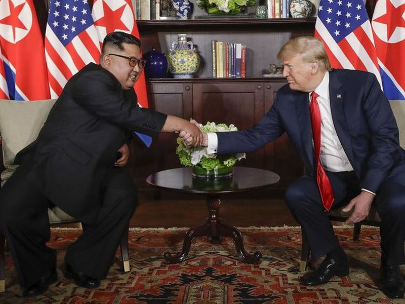 U.S. President Donald Trump shakes hands with North Korea leader Kim Jong Un during their first meetings at the Capella resort on Sentosa Island, in Singapore. (AP)