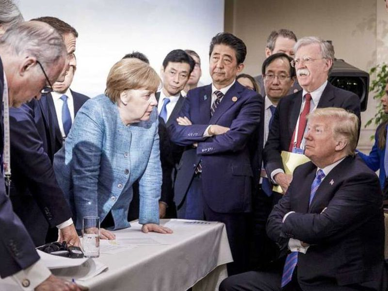 In this photo made available by the German Federal Government, German Chancellor Angela Merkel, center, speaks with U.S. President Donald Trump.