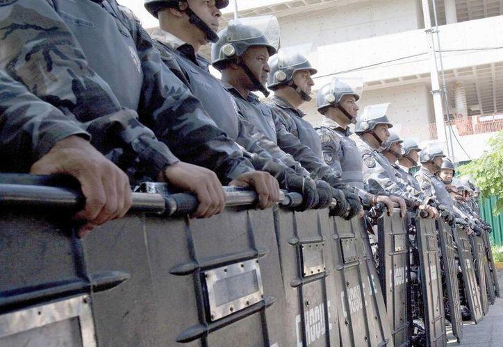 La Policía Militar de Sao Paulo, la capital del estado del mismo nombre, hizo este martes simulacros de reacción ante posibles emergencias. (EFE/Archivo)