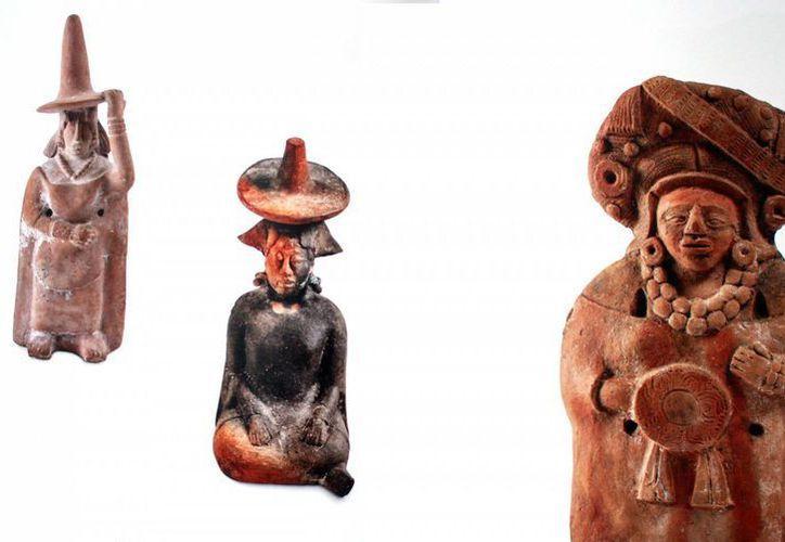 Imagen de las piezas exhibidas en Mérida; presentan en la Filey el catálogo Maya. (Milenio Novedades)