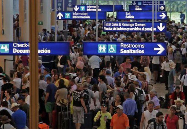 El Aeropuerto Internacional de Cancún recibió un 12.1 por ciento de pasajeros durante mayo de este año, con respecto al año anterior. (Redacción/SIPSE)