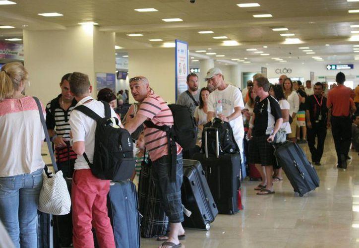 Turistas de Estados Unidos, Canadá y la Unión Europea ya utilizan dicho pasaporte. (Israel Leal/SIPSE)